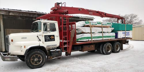 Long Prairie Lumber's delivery boom truck filled with materials for delivery