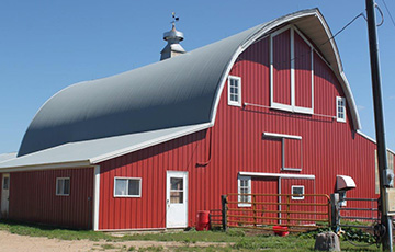 Old barn with new steel siding supplied by Long Prairie Lumber